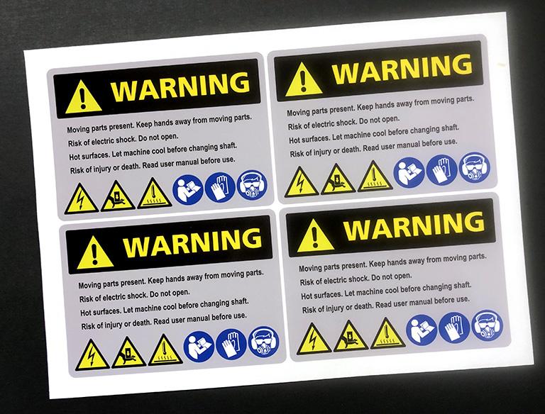 Ohjetarra, varoitustarra, teollisuustarra